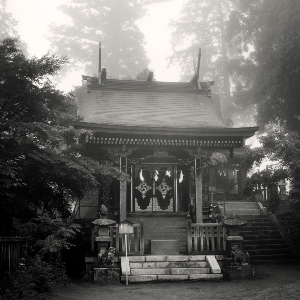 A small shrine in the mist at the summit of Mt Mitake, Tokyo